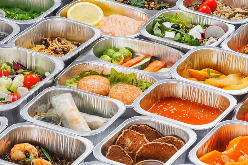 Food in the containers. Separate portions of different food into containers stock image