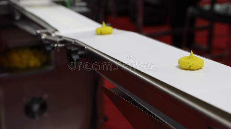 food in conveyor of machine royalty free stock images