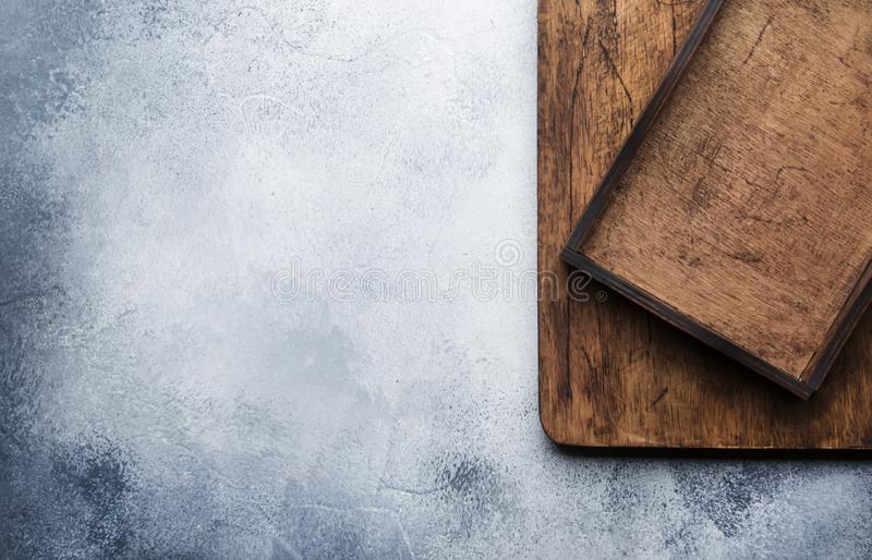 Food cooking background. Gray kitchen table, wooden cutting board and tray. Place for text, horizontal image, view from above royalty free stock photography