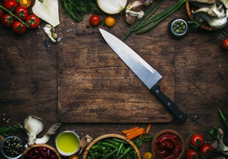 Food cooking background, ingredients for preparation vegan dishes, vegetables, roots, spices, mushrooms and herbs. Big kitchen royalty free stock images