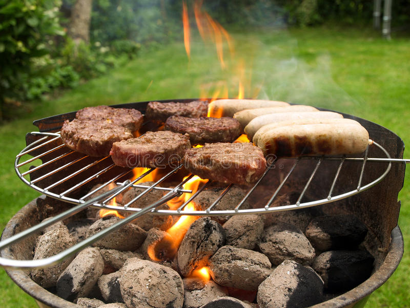 Food cooking on barbecue stock images
