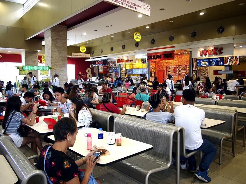 A food court inside the SM City mall in Taytay City, Philippines. TAYTAY CITY, PHILIPPINES - JULY 15, 2017: A food court inside the SM City mall in Taytay City royalty free stock photo