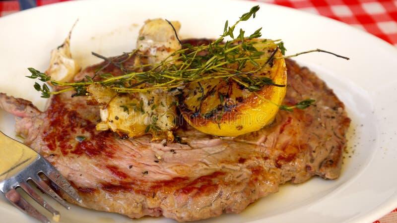 Steak on plate royalty free stock photos
