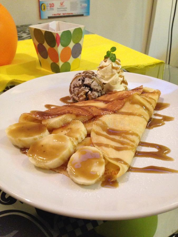 Food. Crape banana caramel icecream stock photos