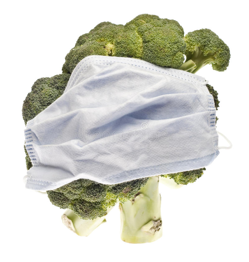 Food Danger Concept. With Broccoli and Surgical Mask. Pesticides or Contamination royalty free stock photos