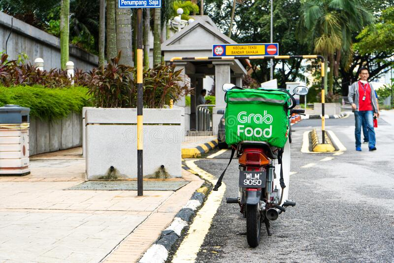 Food delivery bike with a big bag for transporting food. Fast food delivery without traffic jams.  royalty free stock image