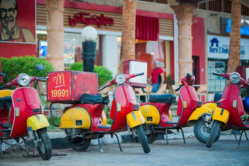 Food delivery motorbikes from McDonald`s and KFS stock photos