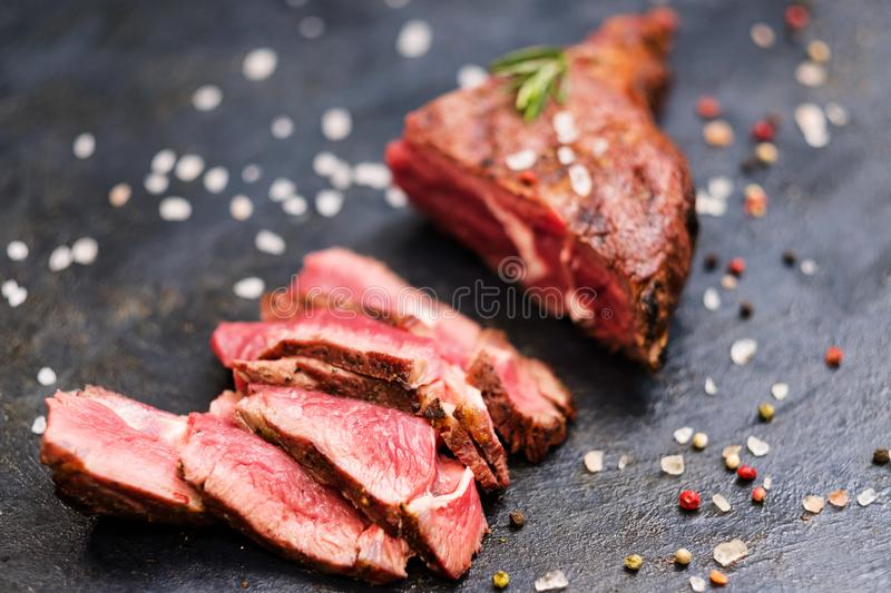 Food delivery service cowboy steak sliced beef stock photos