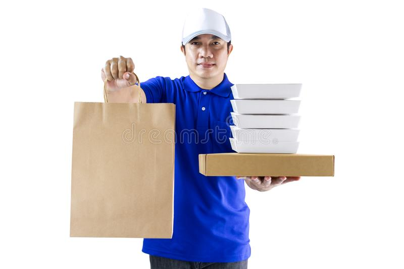 Food delivery service or order food online. Delivery man in blue uniform hand holding food packaging container and paper bag. On the white background. with royalty free stock images