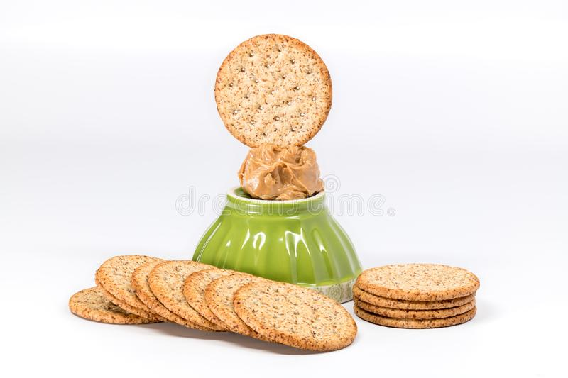 Dab of peanut butter on top of a bowl close up stock photo