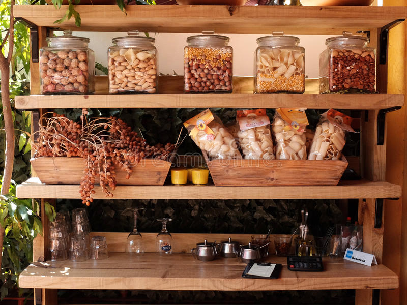 Food display at restaurant. Wooden shelves with various food items on display in a restaurant stock photography