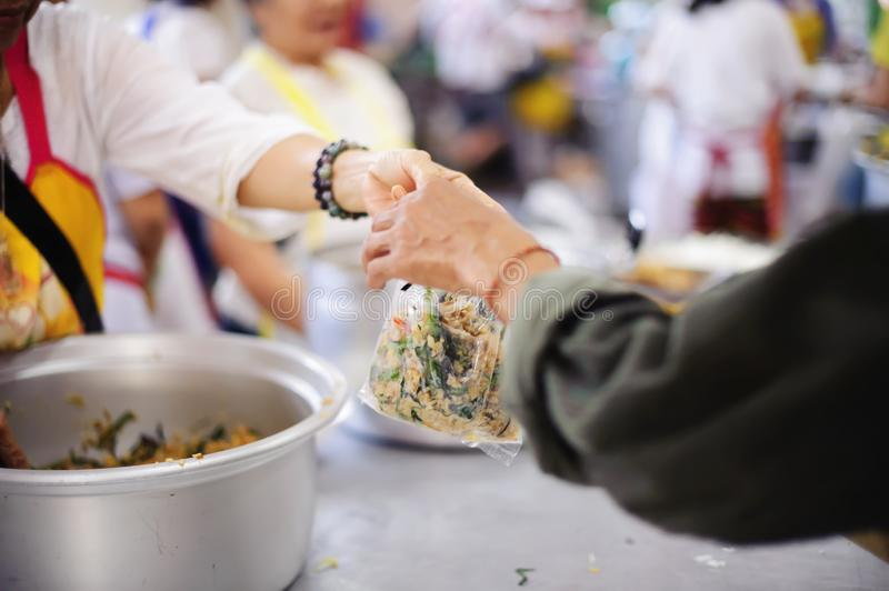 Food donation in the poor community of volunteers : Social concept of poor people sharing.  royalty free stock photo