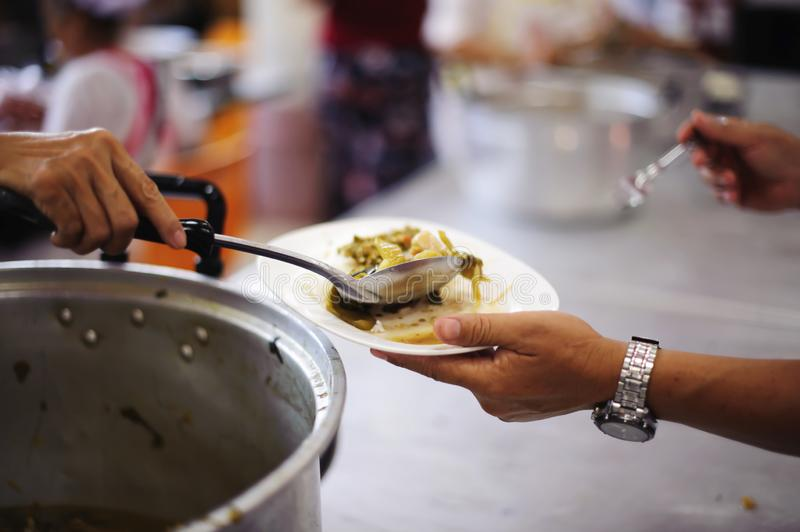 Food donation in the poor community of volunteers : Social concept of poor people sharing.  stock photos
