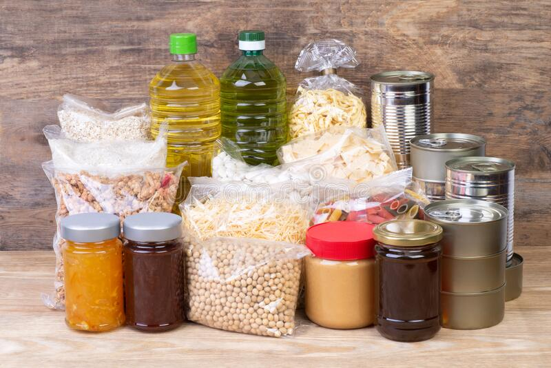 Food donations such as pasta, rice, oil, peanut butter, canned food, jam and other royalty free stock photos