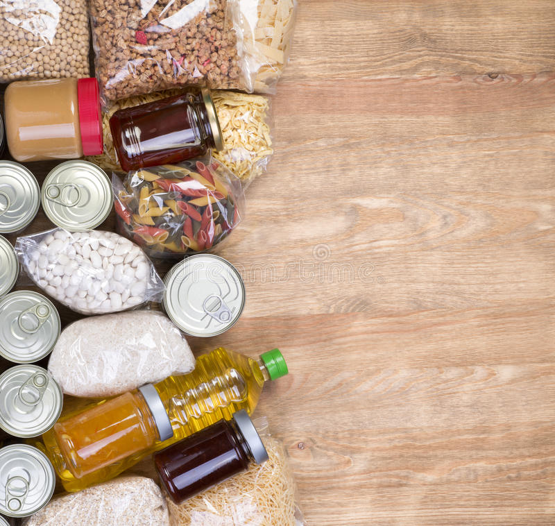 Food donations on wooden background royalty free stock images