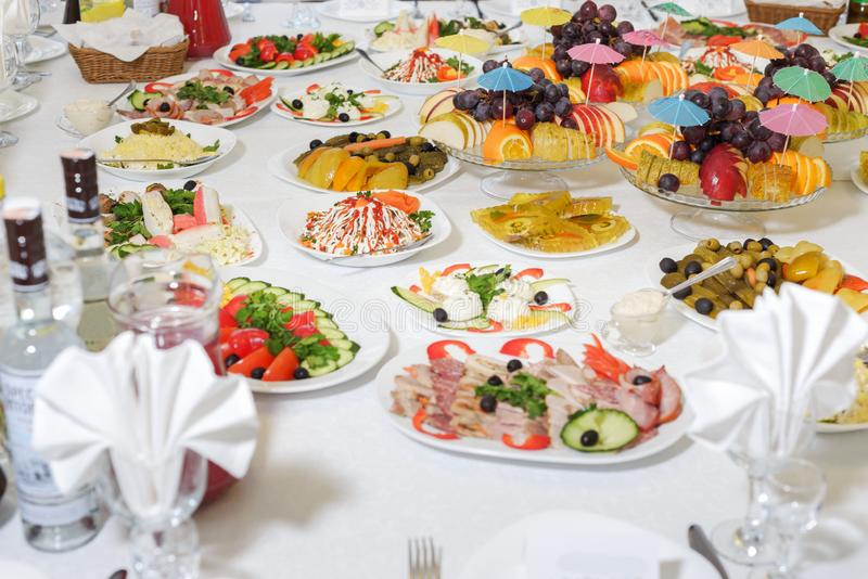 Food and drink at the banquet table. holiday serving.  royalty free stock photos