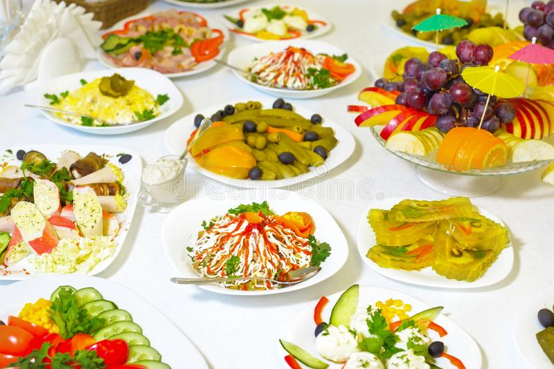 Food and drink at the banquet table. holiday serving.  royalty free stock image