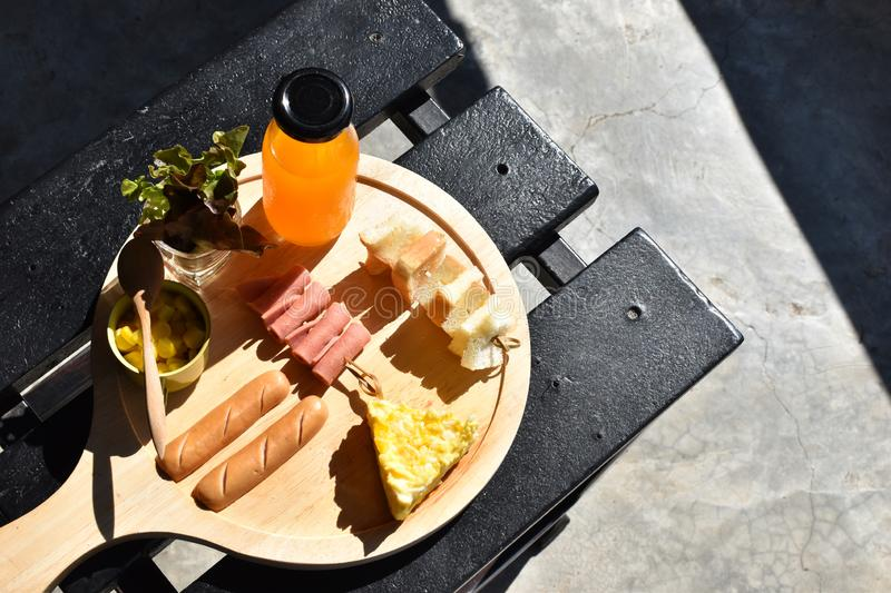 Food and drink concept, breakfast set on wooden table - Image royalty free stock image