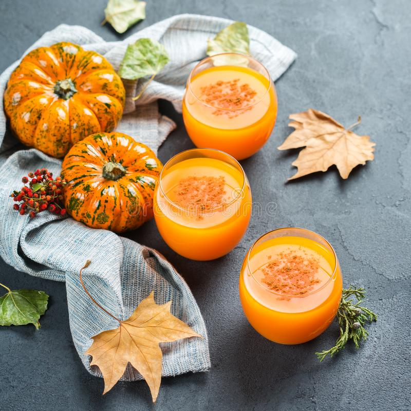 Thanksgiving pumpkin autumn fresh juice drink cocktail beverage royalty free stock photos