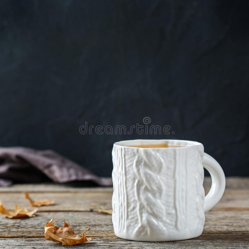 Food and drink, still life concept. Big white mug with hot tea infusion beverage to warm in a cold winter and autumn days. Copy. Space background stock photos