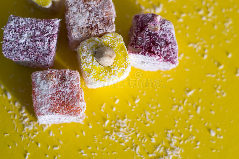 Food and drink, still life concept. Turkish delight with nuts on yellow background stock image