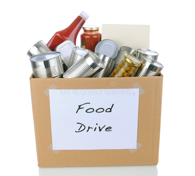 Food Drive Box. A box full of canned and packaged foodstuff for a charity food donation drive. on white with reflection royalty free stock photography