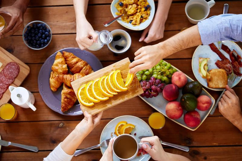 Group Of People Having Breakfast At Table Stock Image ...