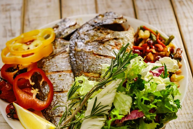 Food fish fresh dorado, meal seafood dinner, cooking pepper. Food fish fresh dorado, meal seafood dinner with vegetables, cooking pepper royalty free stock photo