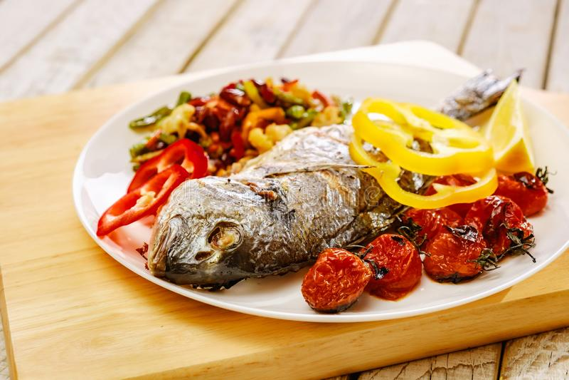 Food fish fresh dorado, meal seafood dinner, pepper. Food fish fresh dorado, meal seafood dinner with vegetables, pepper royalty free stock photos