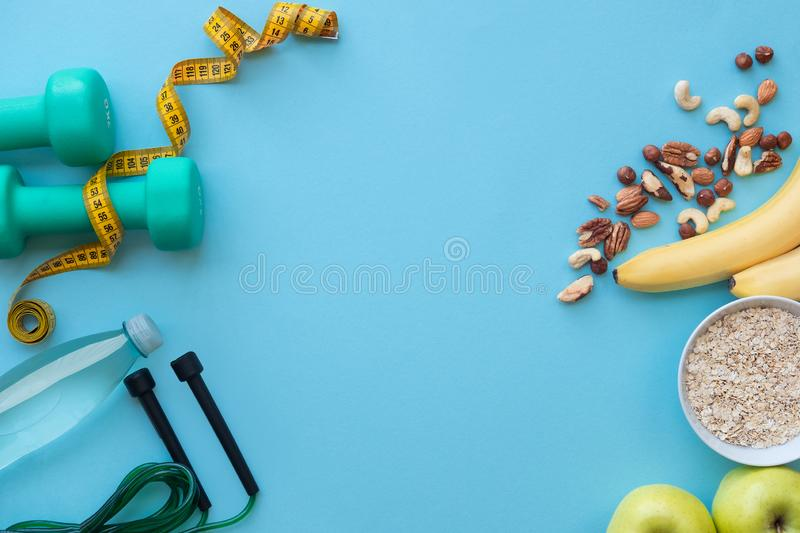 Food for fitness, healthy lifestyle concept on blue background with copy space. royalty free stock photos