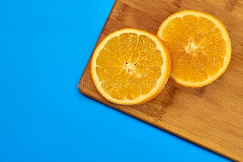 Food for fitness, healthy lifestyle, flat lay with fresh fat-burning fruits, slices of orange on the kitchen cutting board stock image