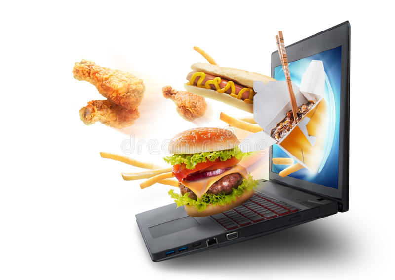Food flying out of a laptop screen stock images