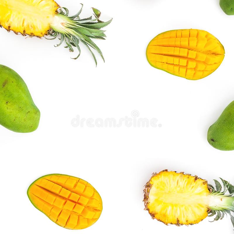 Food frame of pineapple and mango fruits on white background. Flat lay, top view. Tropical concept. royalty free stock photos