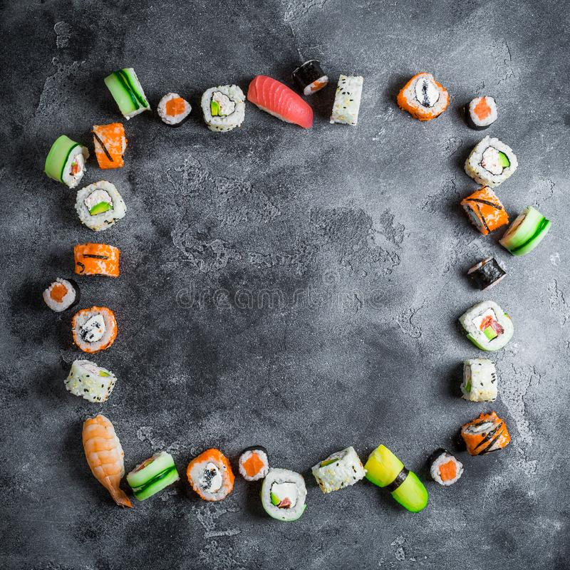 Food frame of sushi rolls on a dark background. Japanese food. Flat lay. Top view stock image