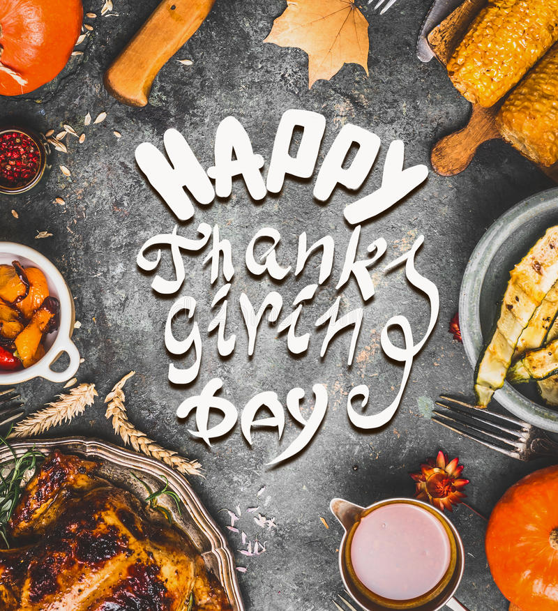 Food frame with various traditional dishes: turkey,pumpkin, corn,sauce and roasted harvest vegetables and text Happy Thanksgiving. Day, greeting card stock image