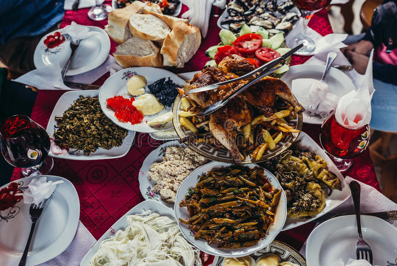 Food in Georgia. Samtskhe-Javakheti region, Georgia - July 21, 2015. Georgian food on a table covered with red tablecloth stock images
