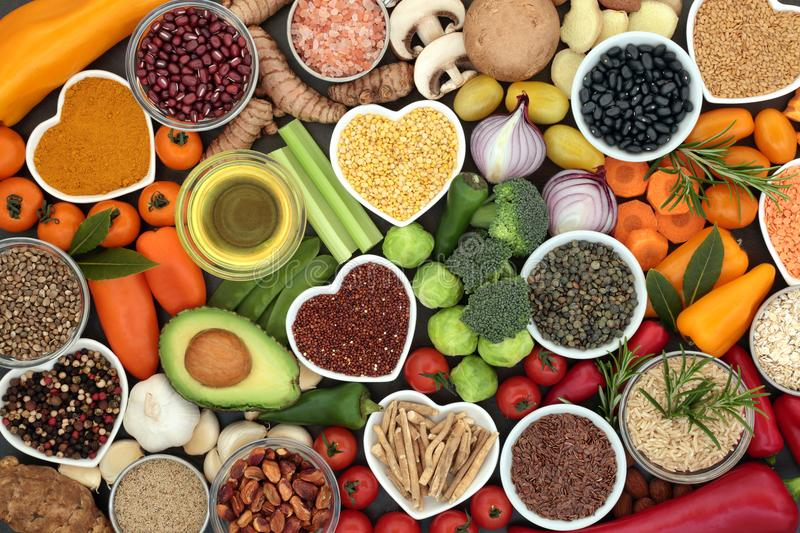Food for Good Health. And fitness concept with fruit, vegetables, pulses, grains, herbs, spices, nuts, seeds, olive oil & himalayan salt. High in antioxidants stock photos