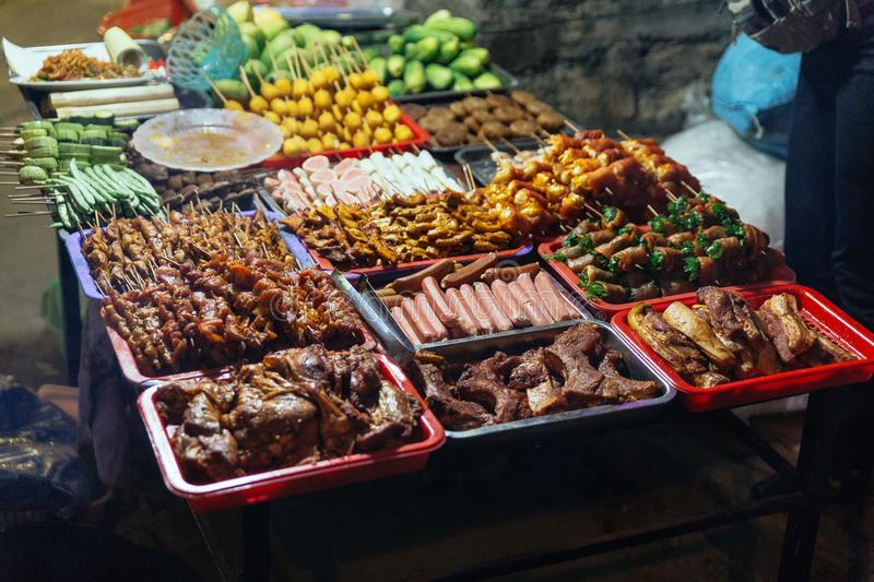 Food for grill such as sausages, meatballs, mushroom, vegetables etc. at the night market in Sa Pa, Vietnam royalty free stock image