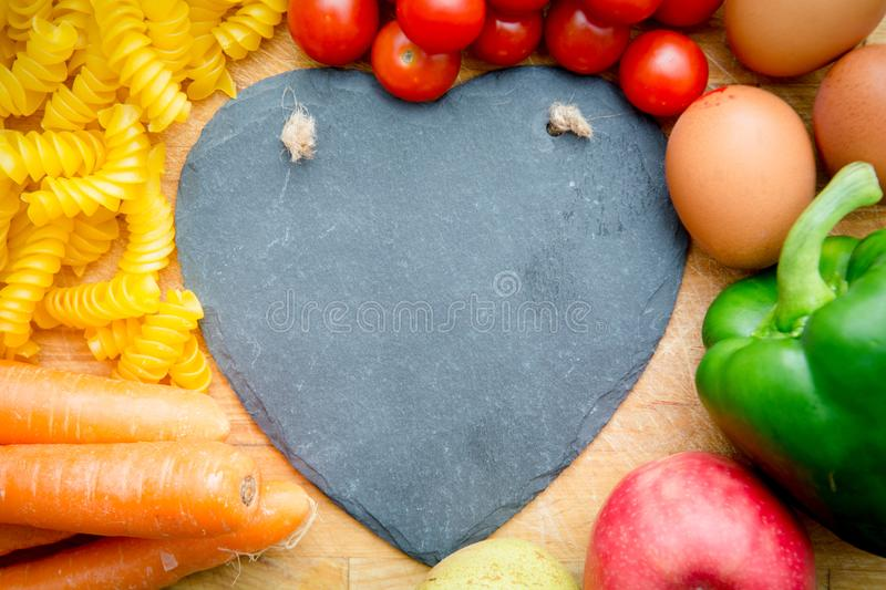 Food groups, natural healthy fruit and vegatables with a heart s. Hape stock photo