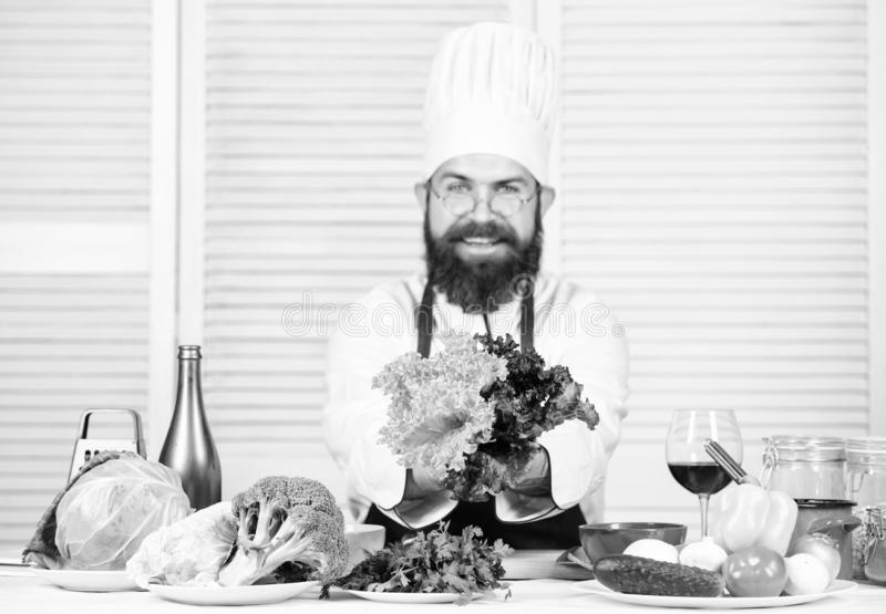 Food habits. Chef man in hat. Secret taste recipe. Bearded man cook in kitchen, culinary. Healthy food cooking. Dieting stock photos
