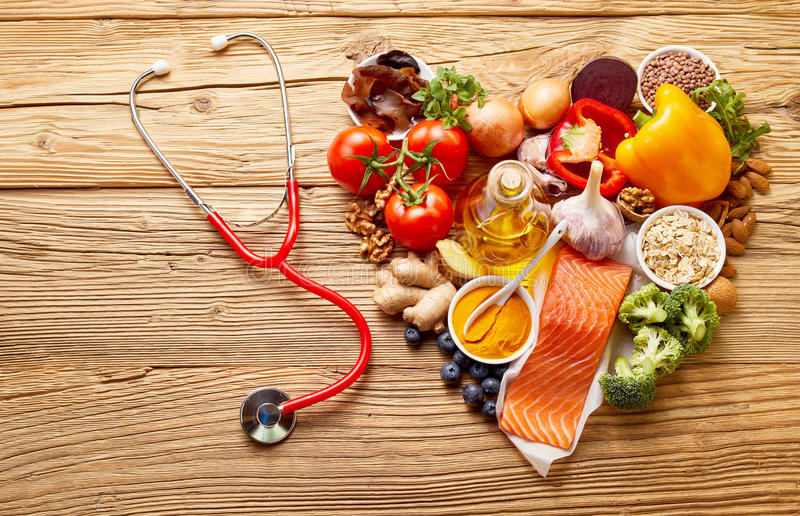 Food in heart shape with stethoscope royalty free stock images