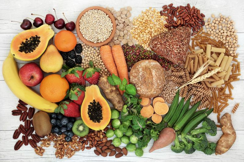 Food with High Fiber Content. Food with high fibre content for a healthy diet with fruit, vegetables, whole wheat bread, pasta, nuts, legumes, grains and cereals stock photography