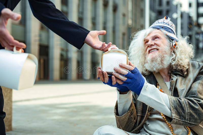 Charity man encouraging other people giving food for homeless. Food for homeless. Successful influencing charity men encouraging other people giving food for royalty free stock images