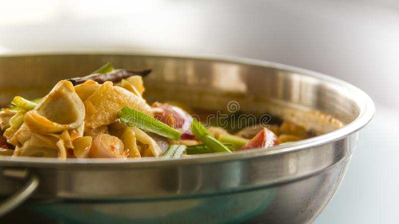 Food in a hot pot stock image