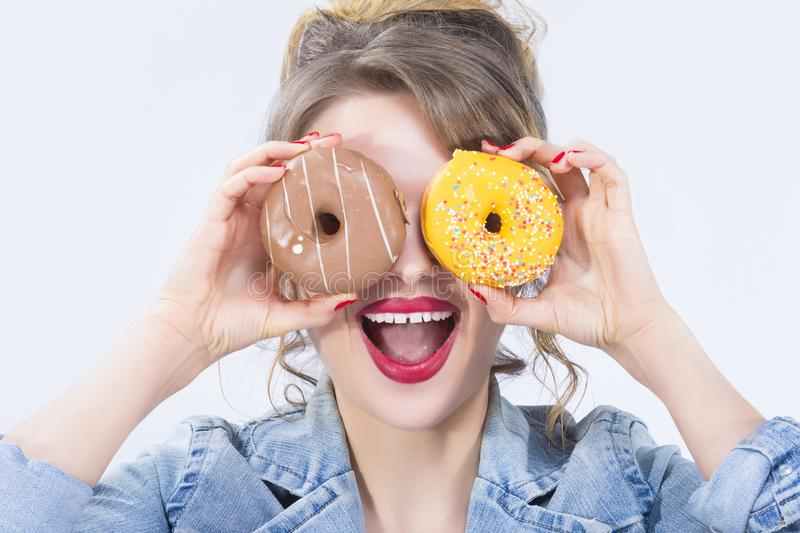 Food Ideas and Concepts. Portrait of Young Surprised Caucasian Blond With Donut royalty free stock images