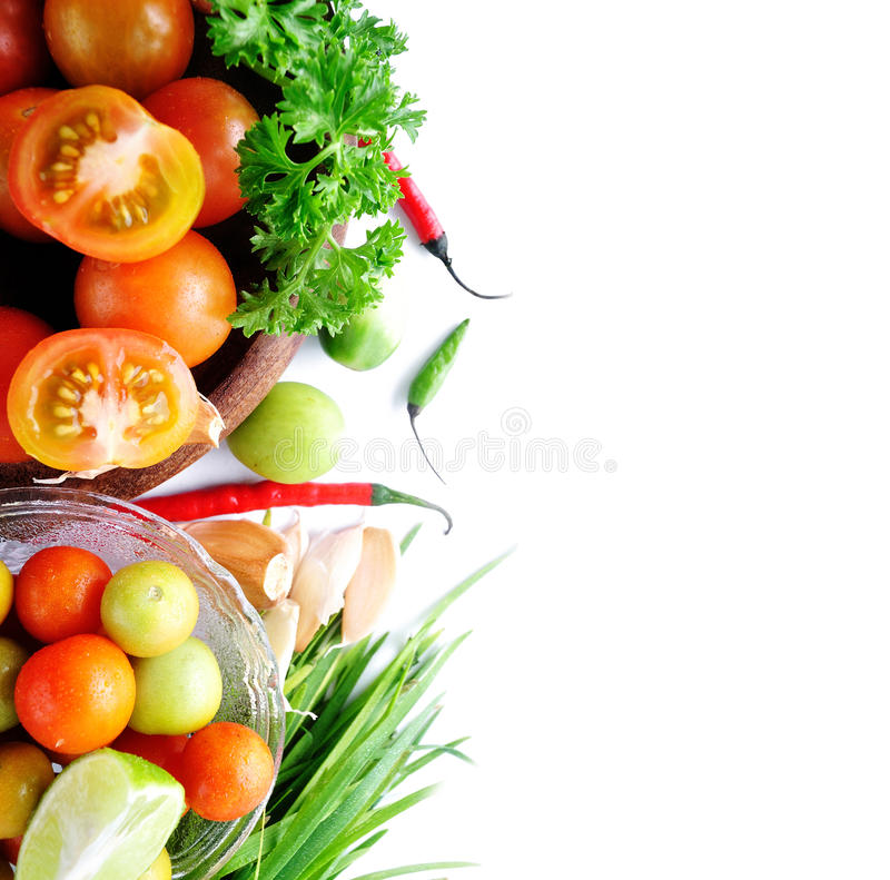 Food ingredient. With Tomato, chives, garlic, red chili, lettuce and parsley on white background with sample text stock images