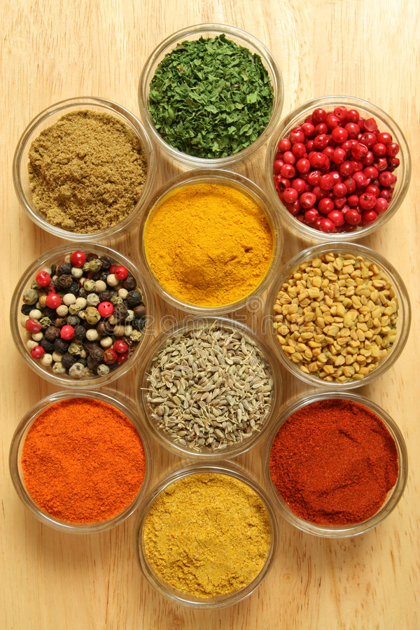 Food ingredients. Spices and herbs in small glass bowls. Food and cuisine additives. Colorful natural ingredients royalty free stock image