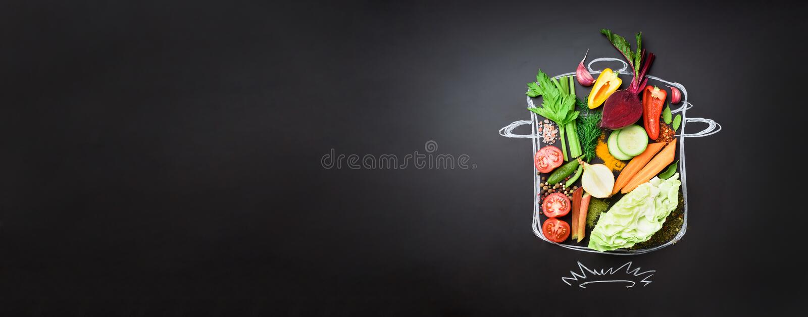 Food ingredients for blending creamy soup on painted stewpan over black chalkboard. Top view with copy space. Organic royalty free stock photos