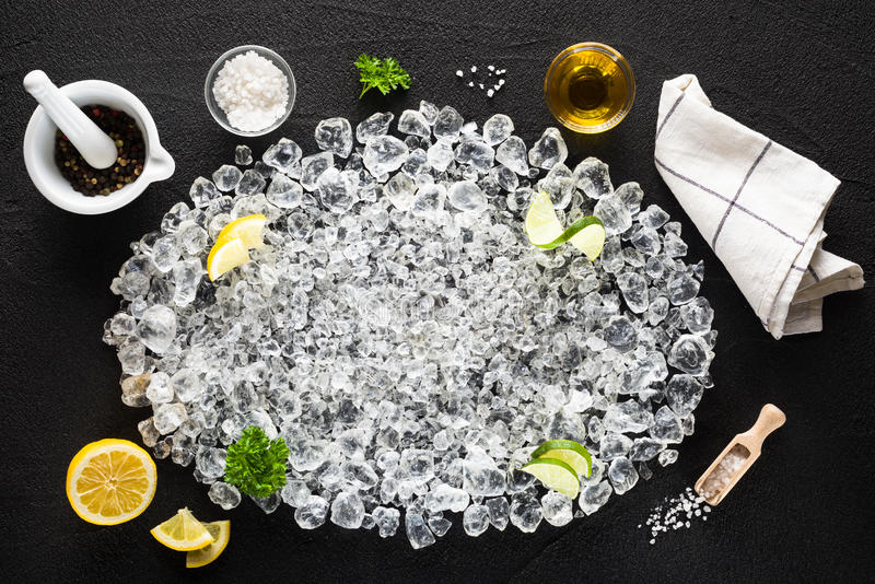 Food ingredients and crushed ice on black table royalty free stock photography
