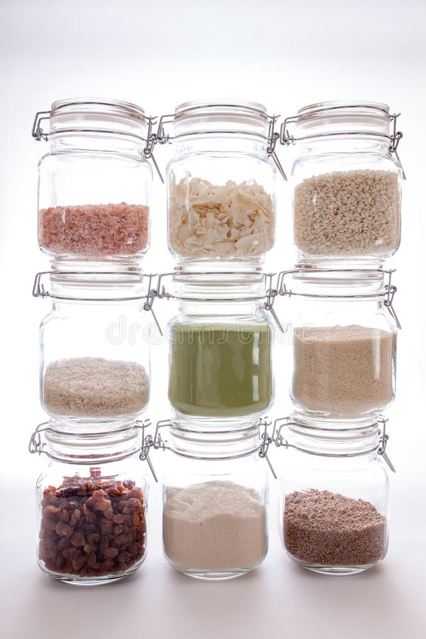 Food ingredients. Glass kitchen storage jars with various cooking foodstuff stock photos